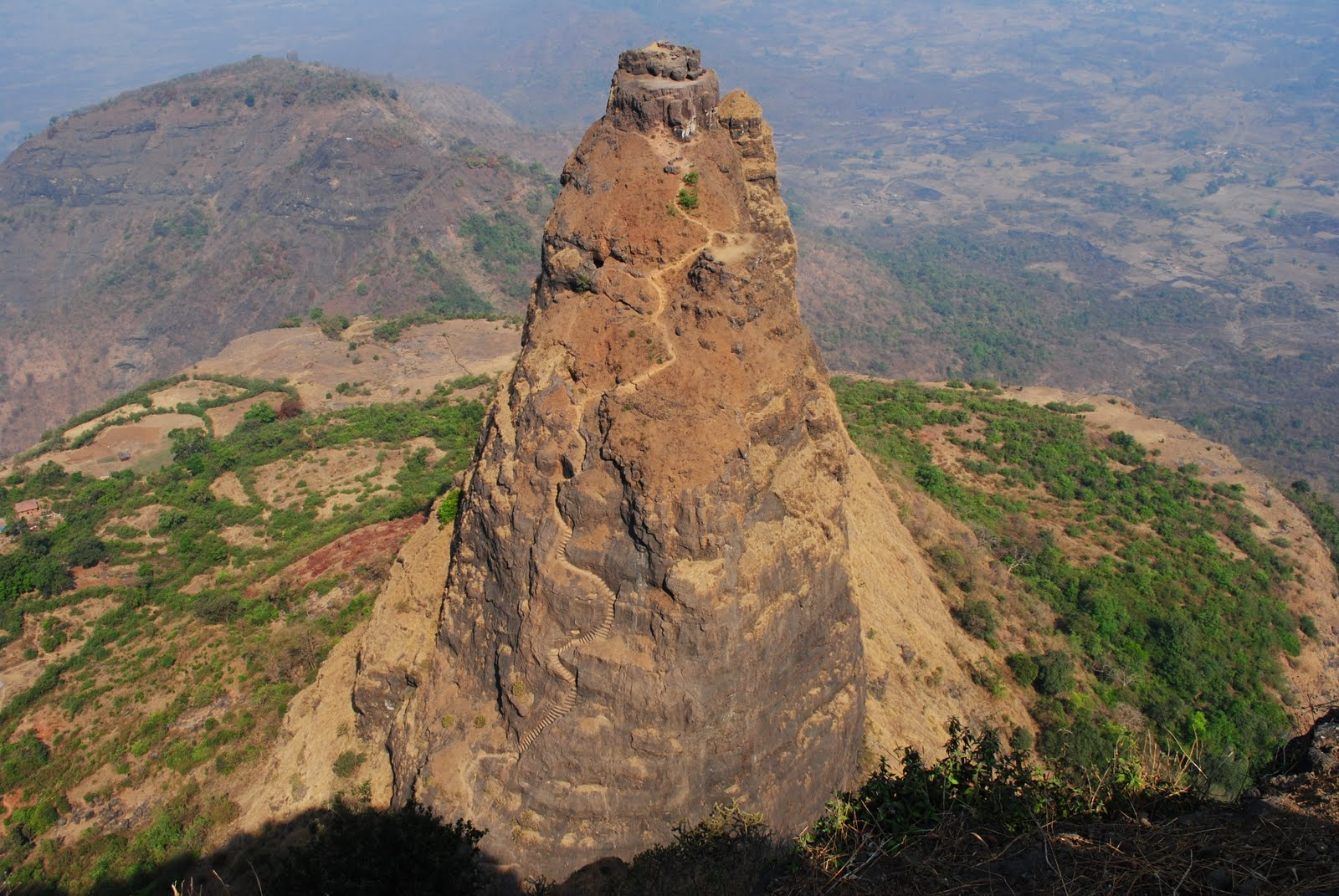 Prabalgad Fort dating from around 1458. Carved out of the rock at an an elevation of 2,300 feet. Maharashtra, India.